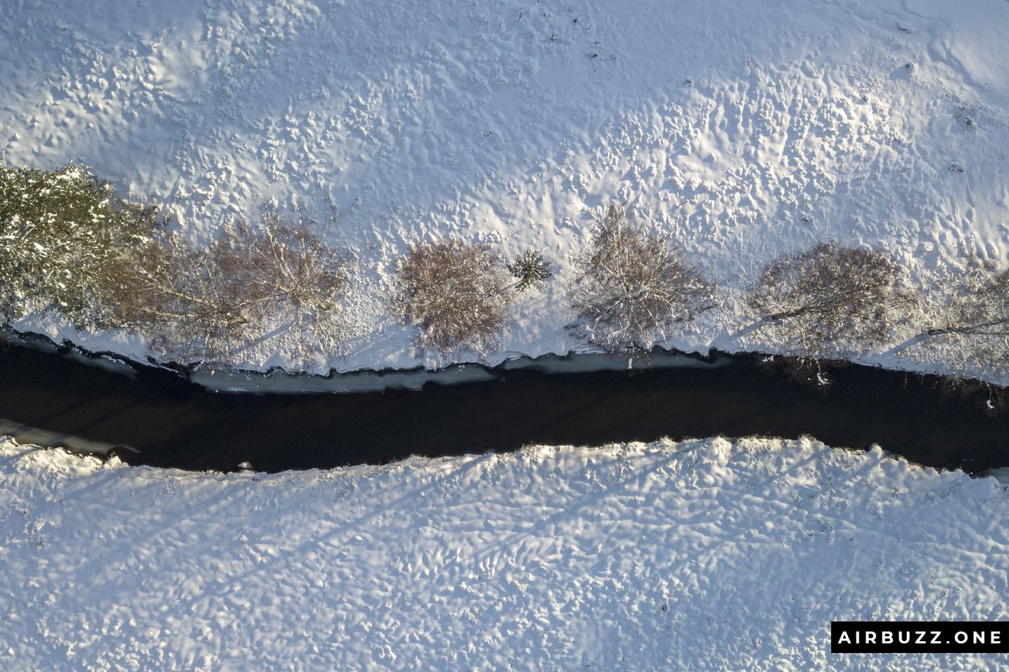 Øverlandselva with trees on one side.