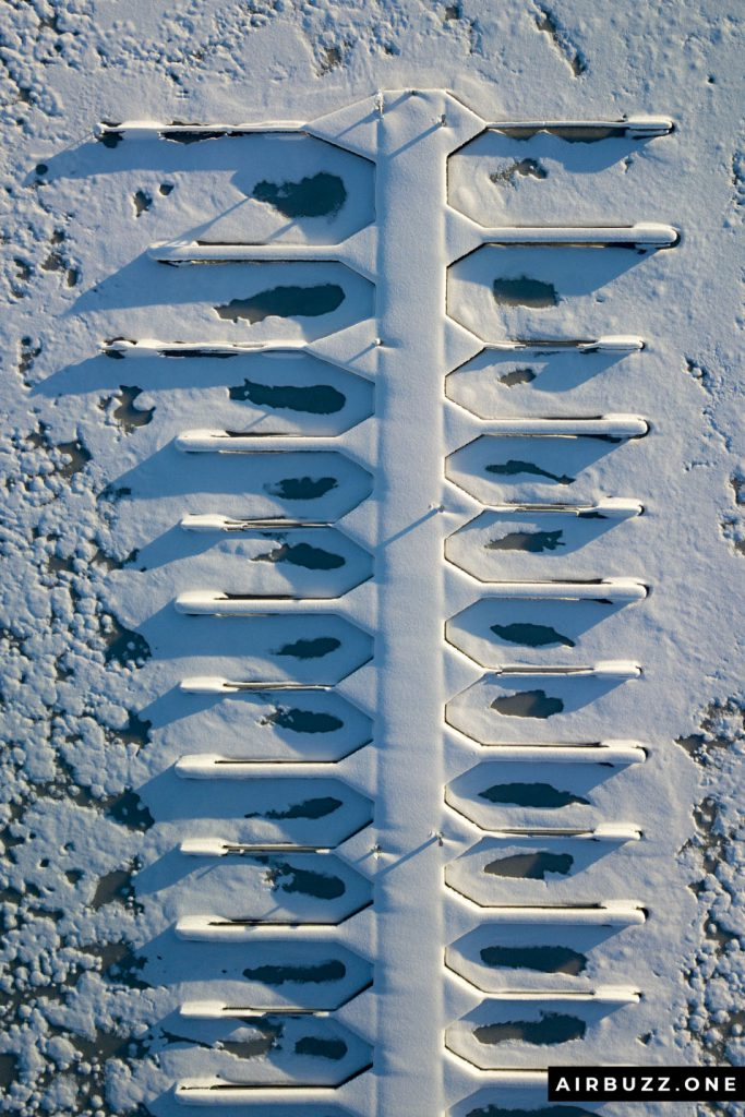 The straight down drone picture of the empty boat parking looks like a fish skeleton or something... Guess the picture would be even better with just one old boat lying there.