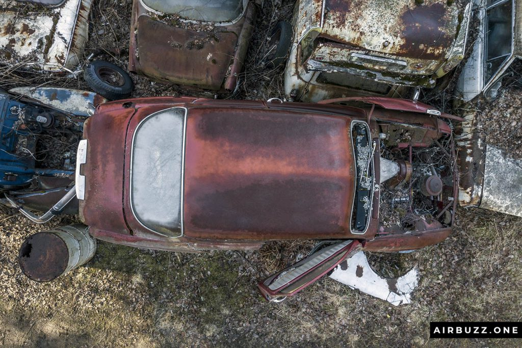 Red, rusty, forgotten car.