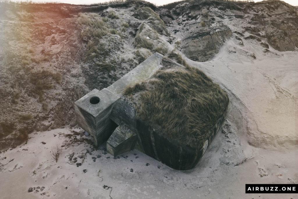 Recently fallen concrete bunker.