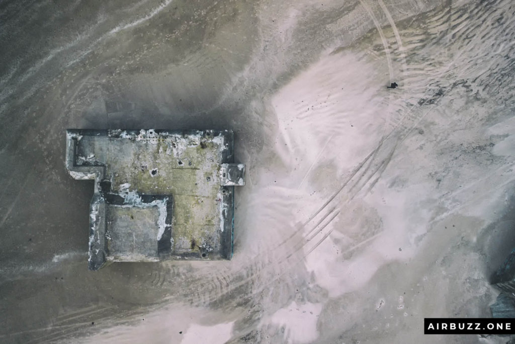 Straight down drone shot of the beach, me and a bunker.